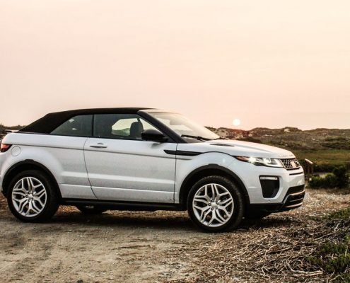 rent range rover evoque convertible | on the beach with Car4rent luxury vehicle hire
